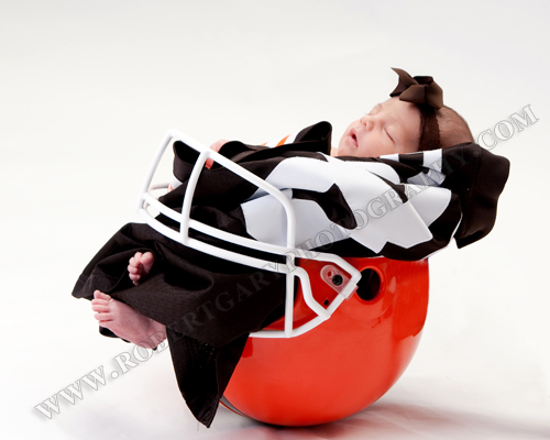 Newborn baby in cleveland browns football helmet